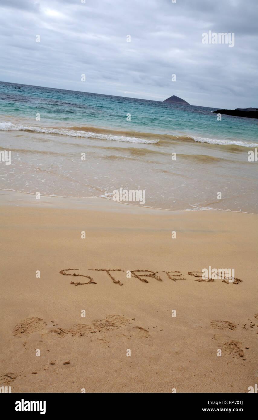 under stress at Punta Cormoran, Floreana Island, Galapagos Islands, Ecuador in September - word stress written in - Stock Image