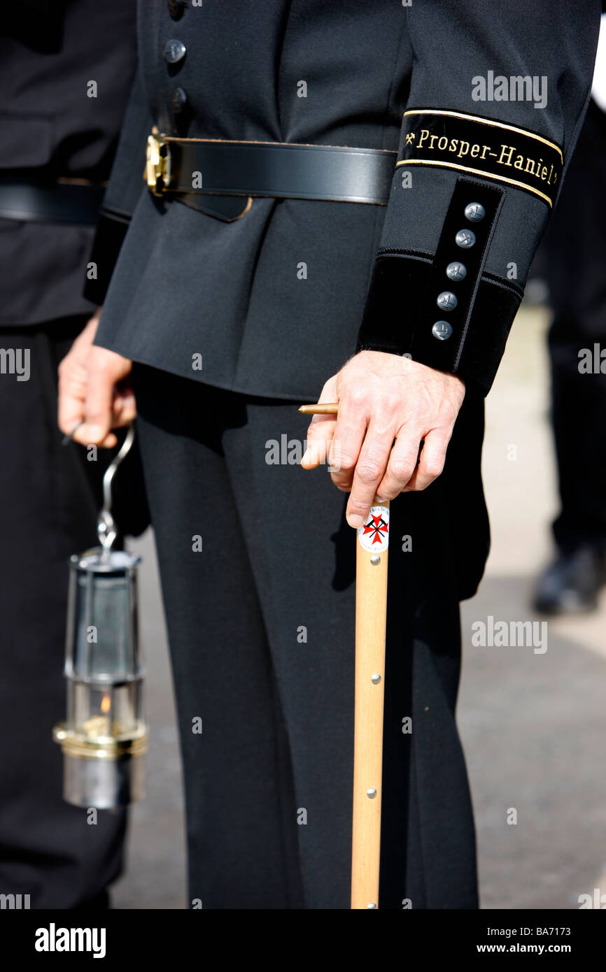 Uniform of a german coal mineworker. Traditional uniform with an old miners's lamp, Germany, Bottrop. - Stock Image