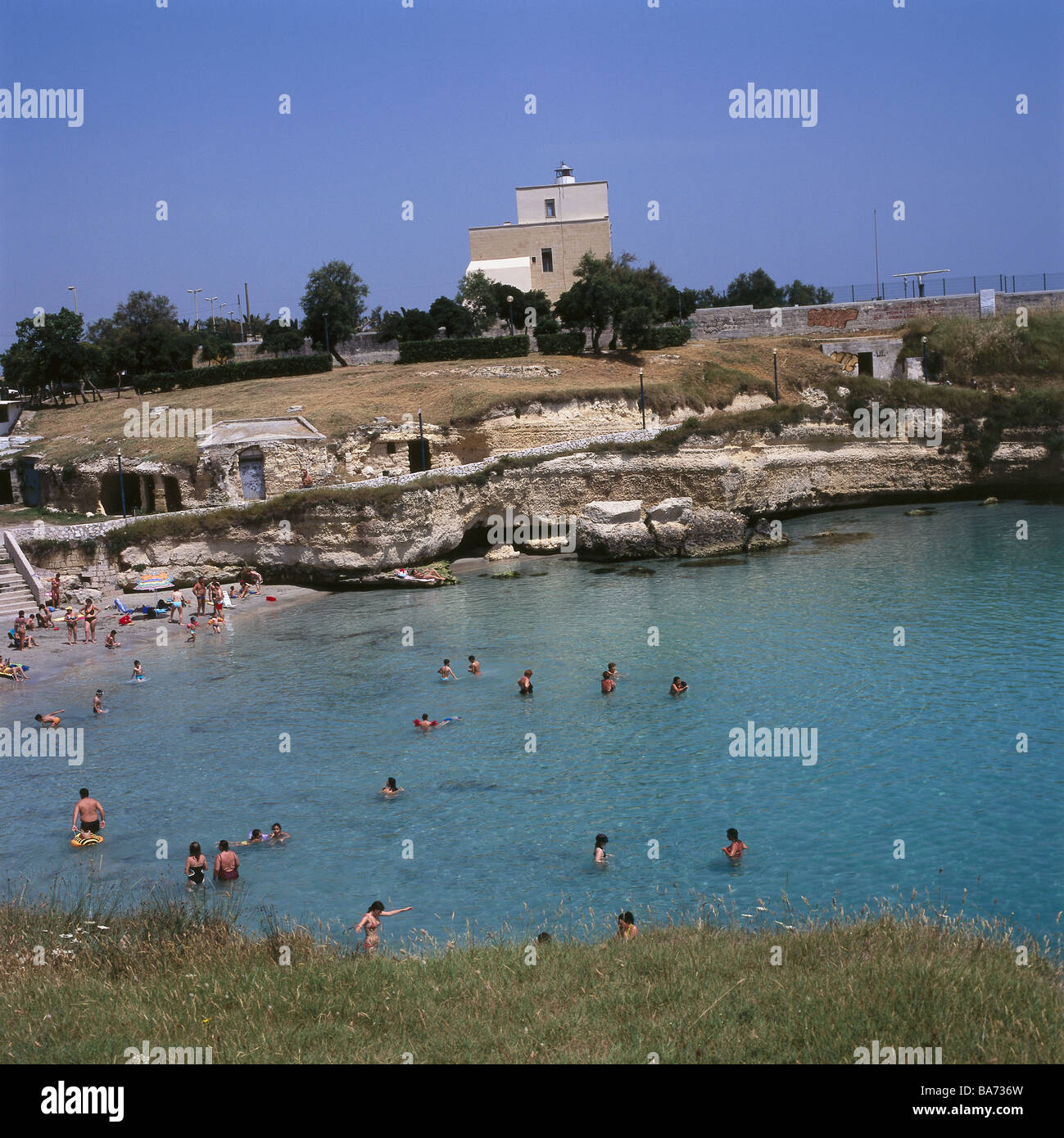 Italy Apulien models beach swimmers no Torre S. Andra place-opinion release South-Italy Salento coast people tourists - Stock Image