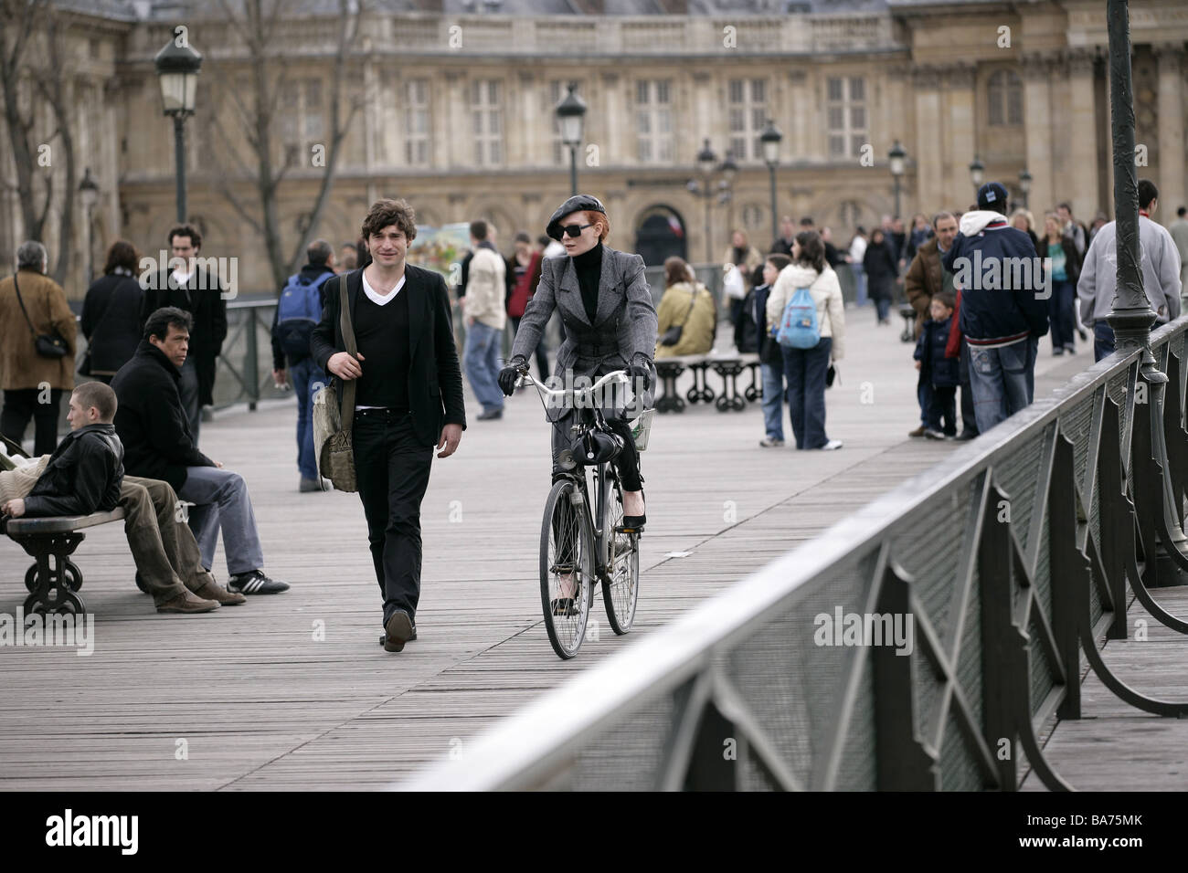 France Paris models Pont of the Art passers-by no release outside bridge Europe France pedestrians capital autumn - Stock Image