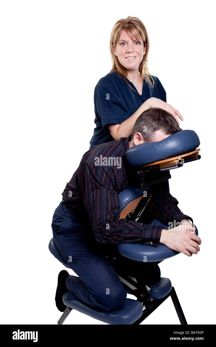 man getting a therapeutic chair massage from a female therapist Stock Photo