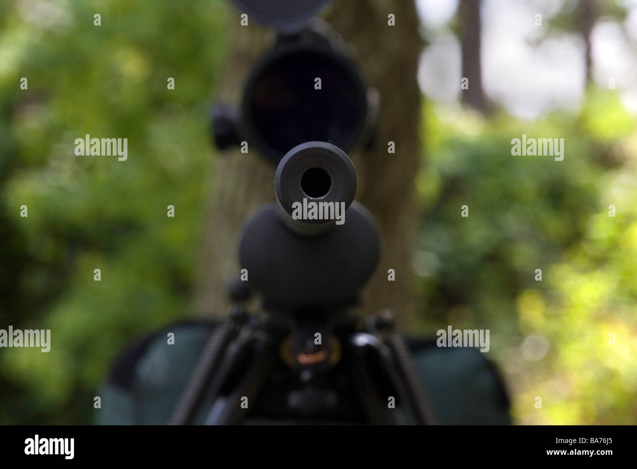 Military police sniper rifle is posed ready for use in the field. - Stock Image