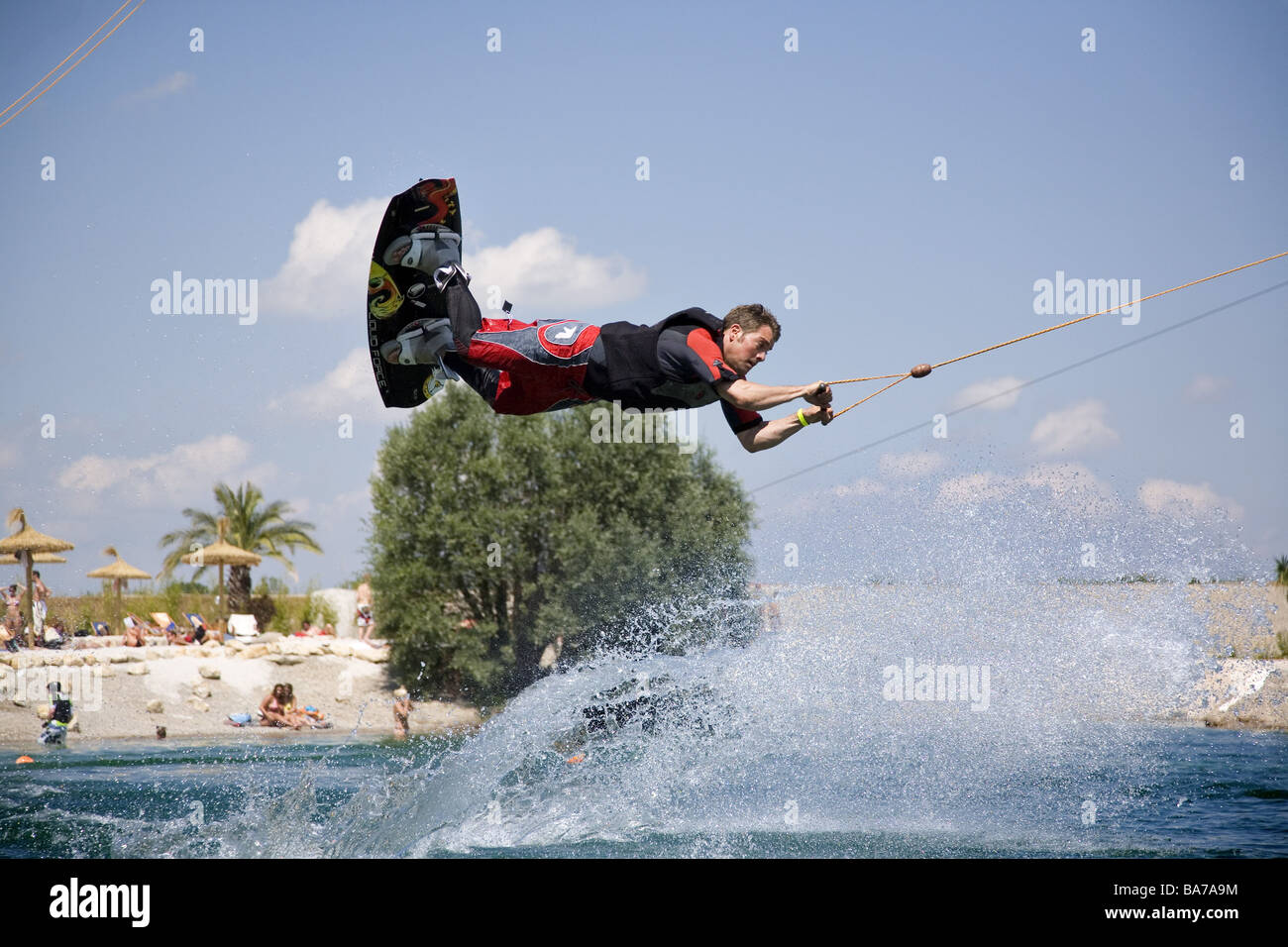 wakeboarder jump people man athletes water athletes wakeboard air jump water sport sport activity fitness dynamics proficiency