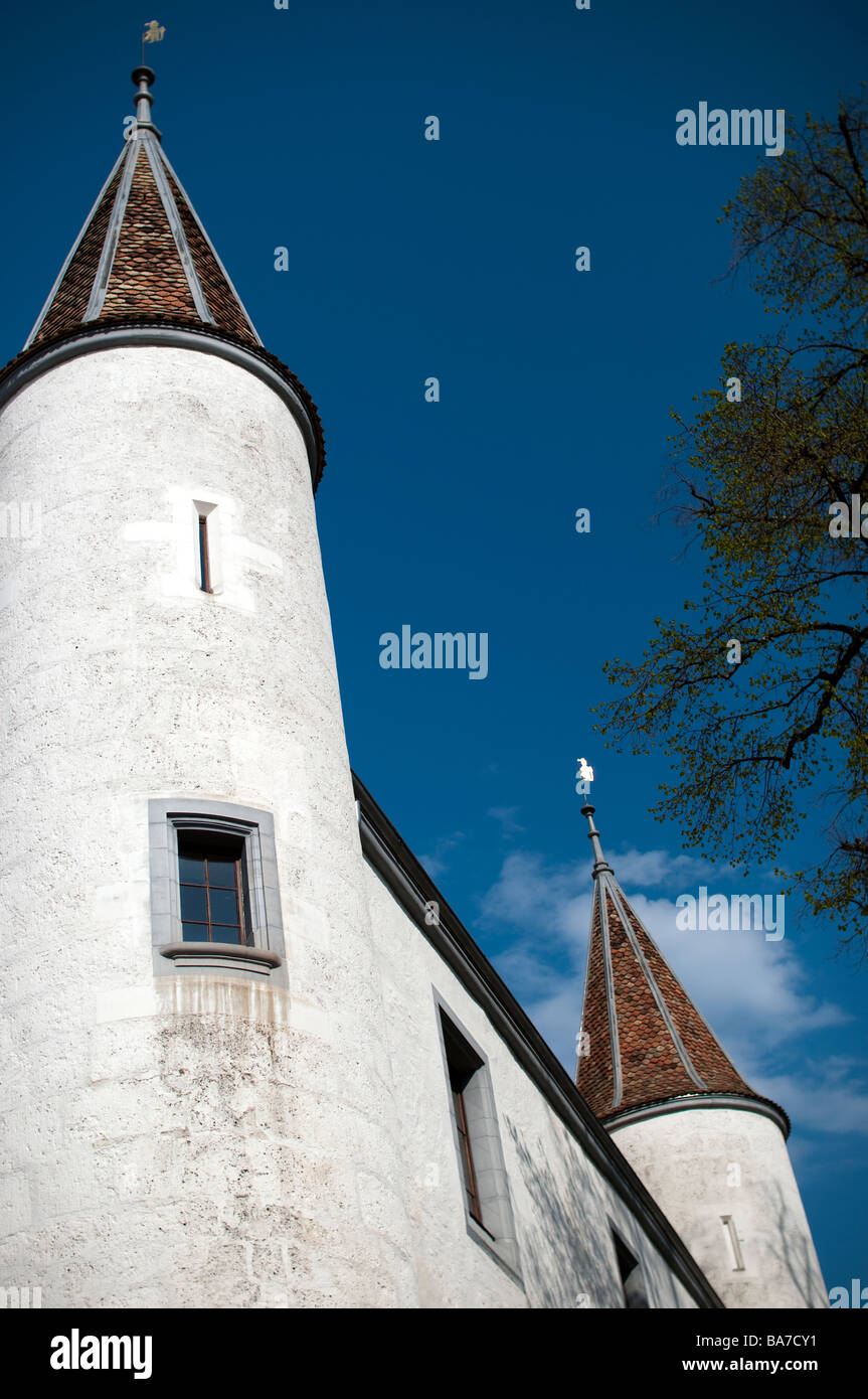 Towers of the Château de Nyon, Switzerland, a white castle built on teh site of an ancient roman fortress overlooks - Stock Image