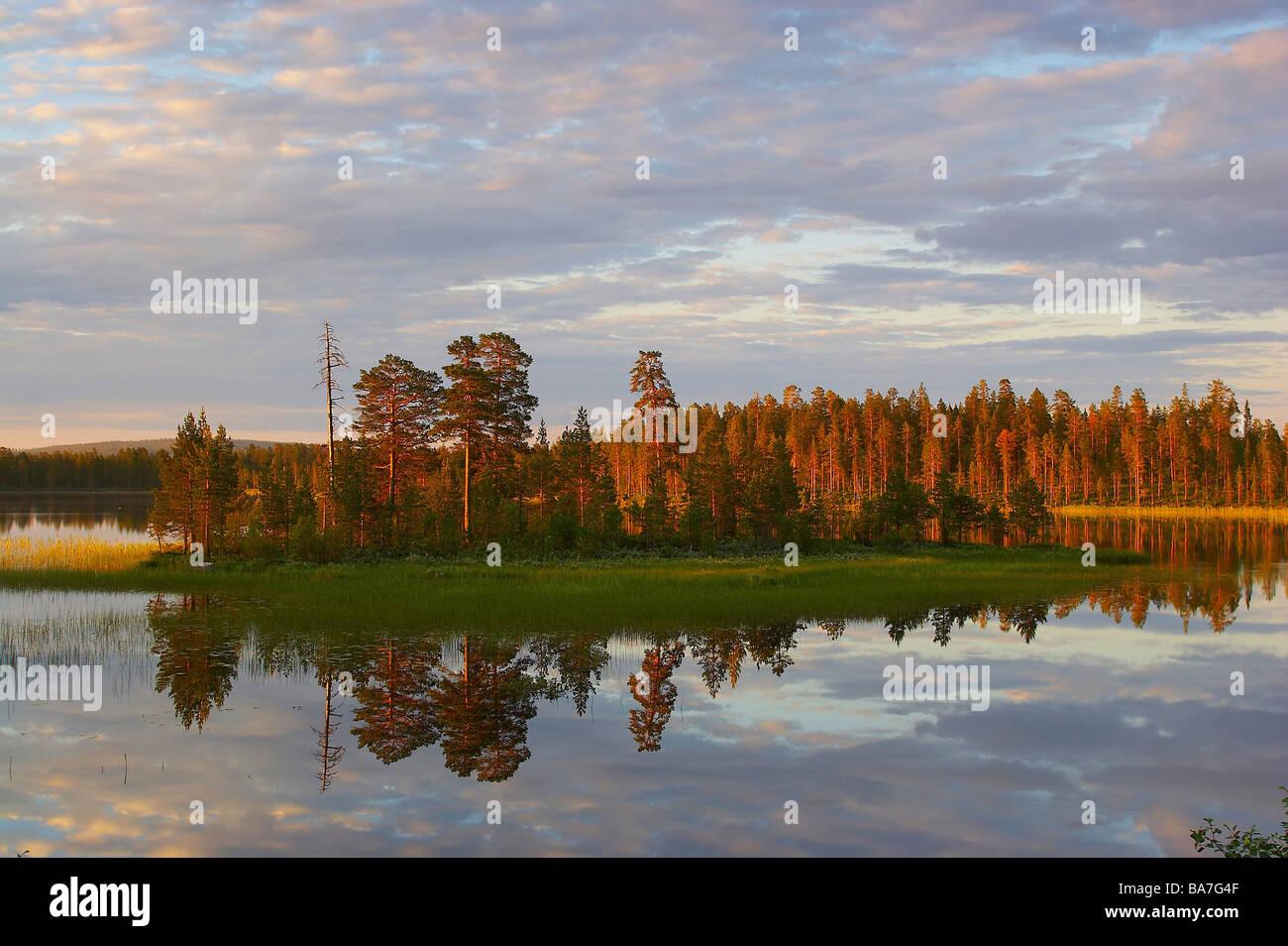 Lake near Floetningen in Dalarna in the first morning light, middle Sweden - Stock Image