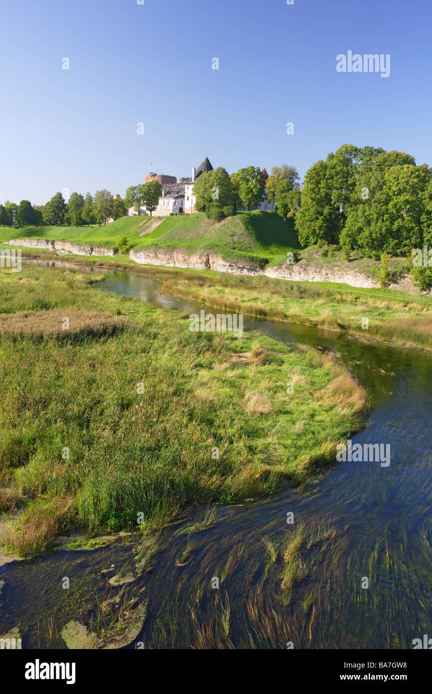 Bauska castle, built 1443, river Musa in the foreground, Bauska, Latvia - Stock Image