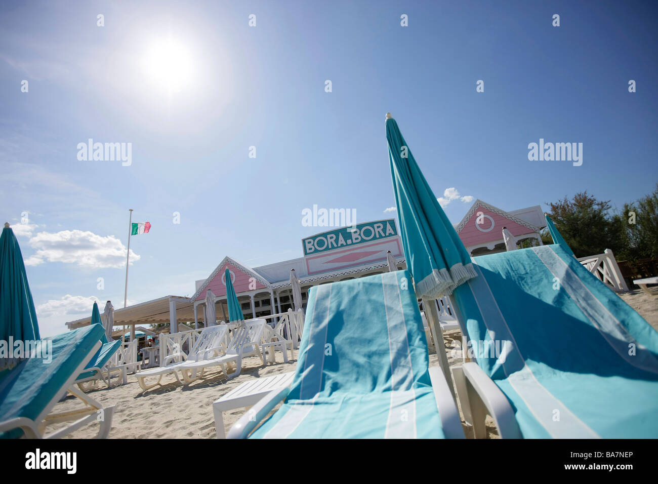 Sunshades and sun loungers on Tahiti beach, St. Tropez, Cote d'Azur, Provence, France - Stock Image