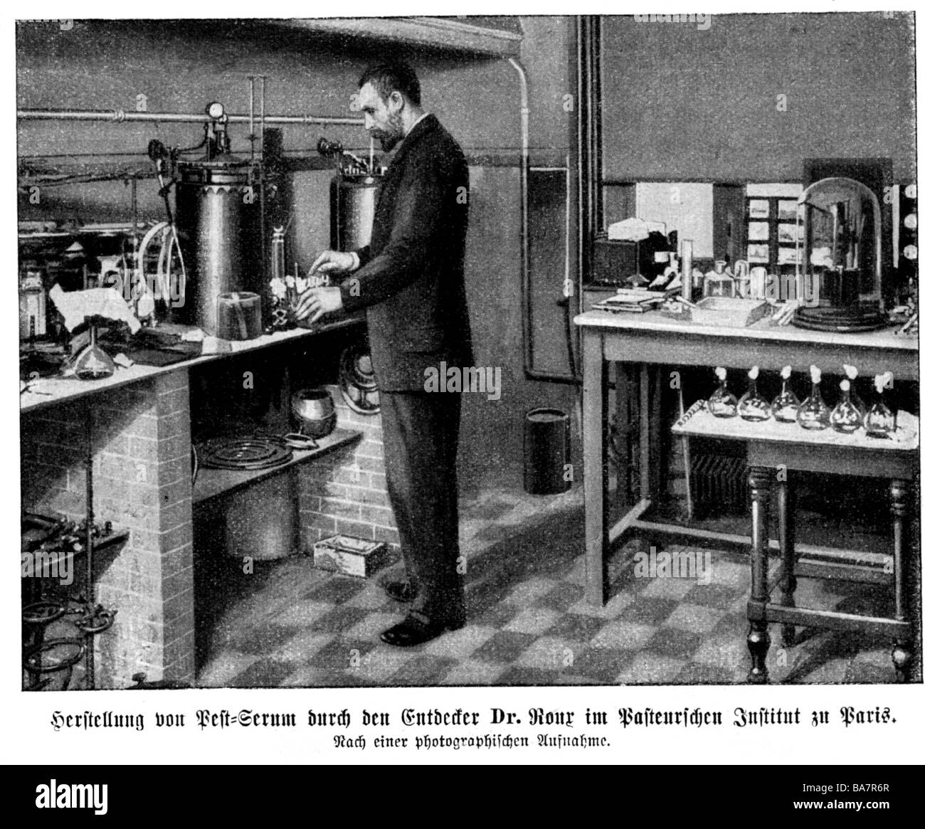 Roux, Pierre Paul Emile, 17.12.1853 - 3.11.1933, French bacteriologist, full length, at his laboratory, producing - Stock Image