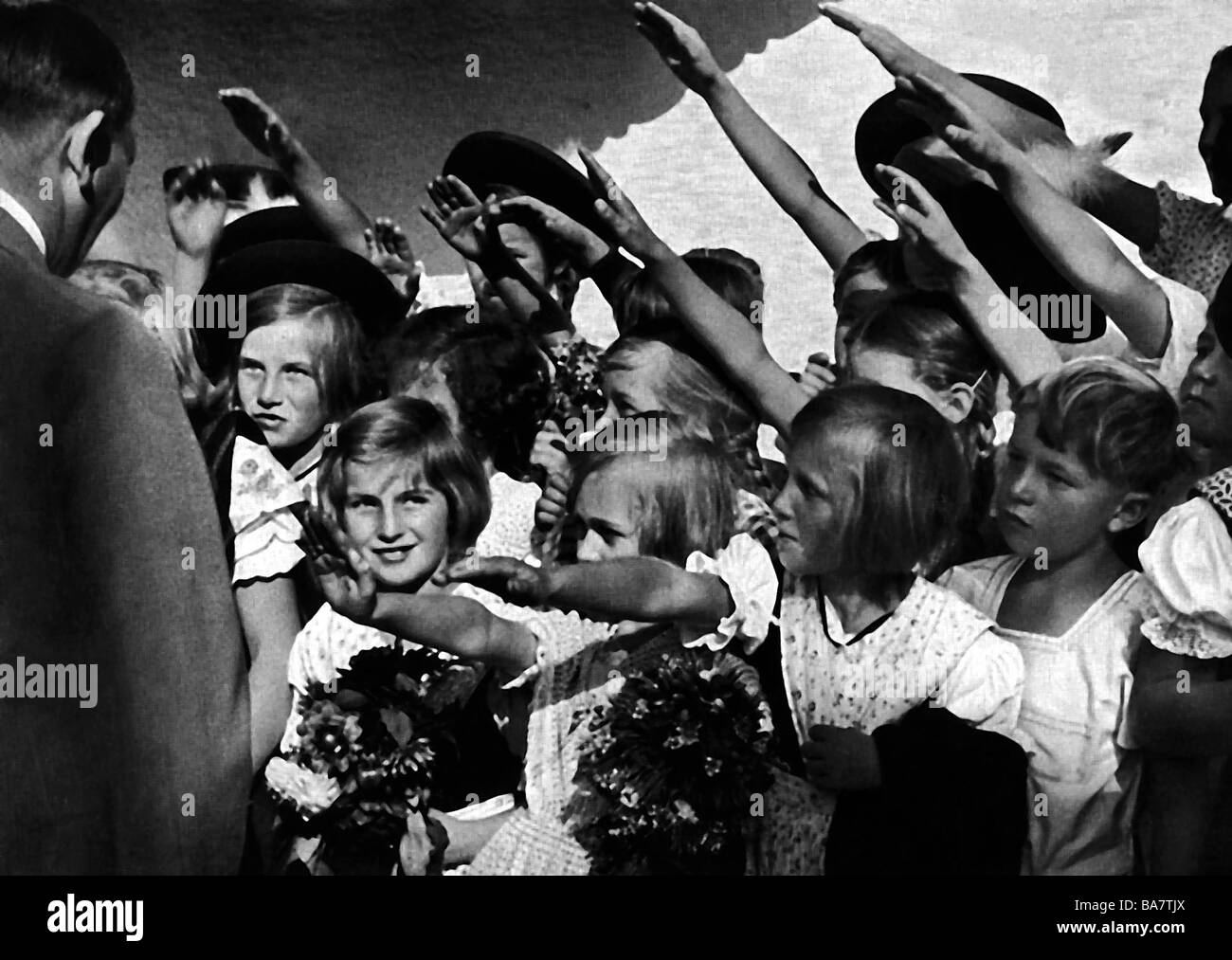 Hitler, Adolf, 20.4.1889 - 30.4.1945, German politician (NSDAP), children saluting him, Additional-Rights-Clearances - Stock Image