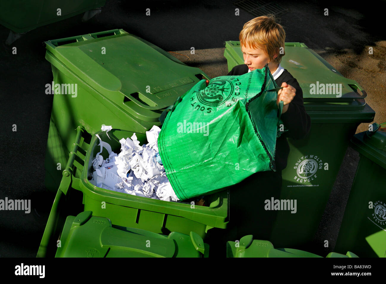 school pupil recycling paper *EDITORIAL USE ONLY* - Stock Image