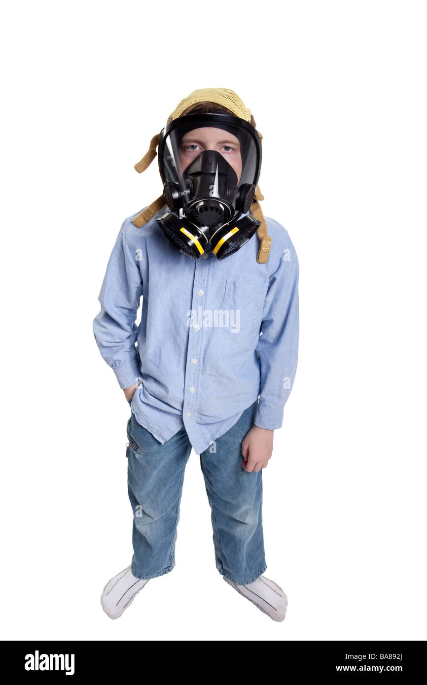 young boy wearing a gas mask - Stock Image