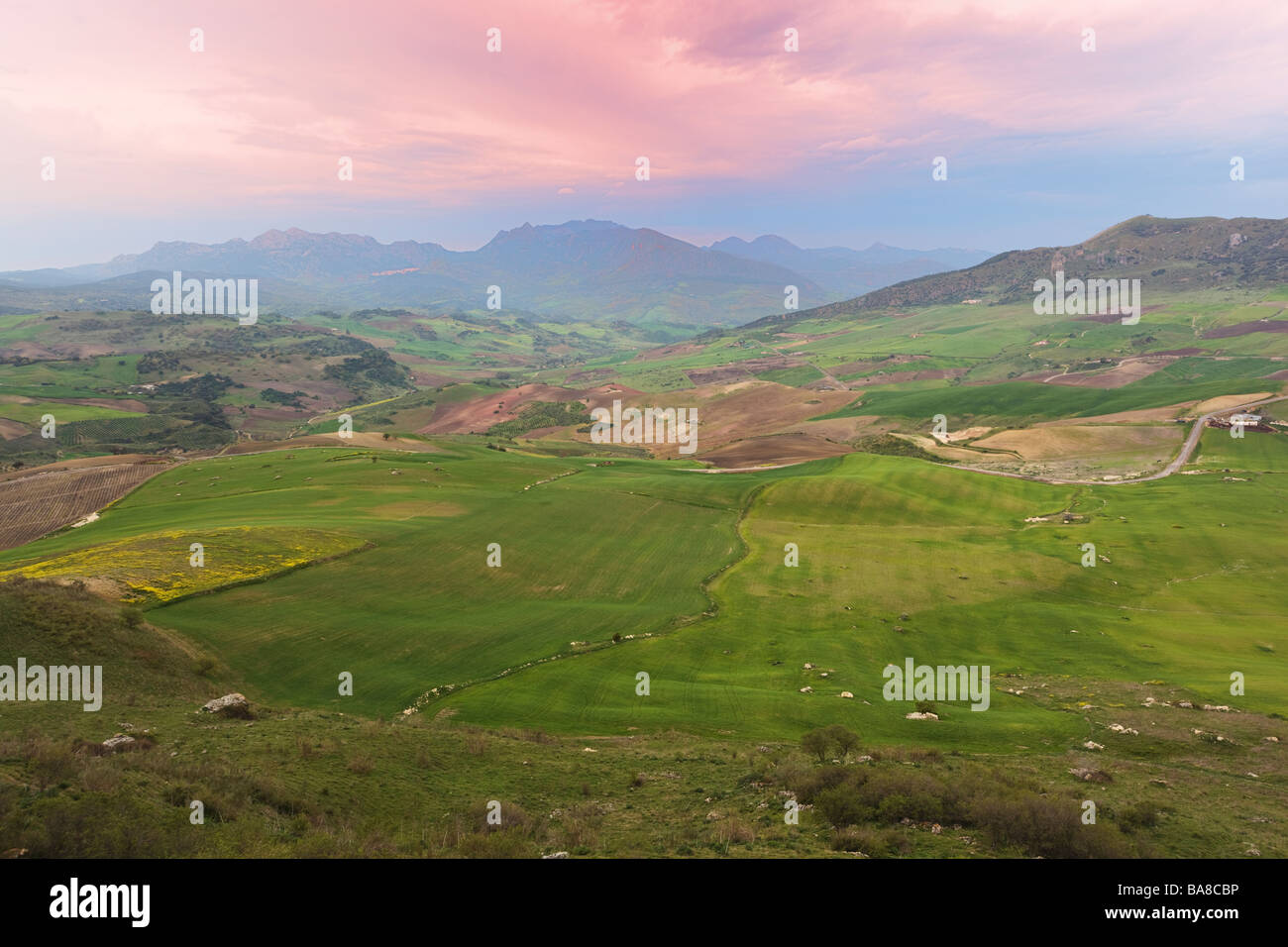 Countryside in the Serrania de Ronda in front of Roman ruins of Acinipo, Malaga Province, Spain. - Stock Image
