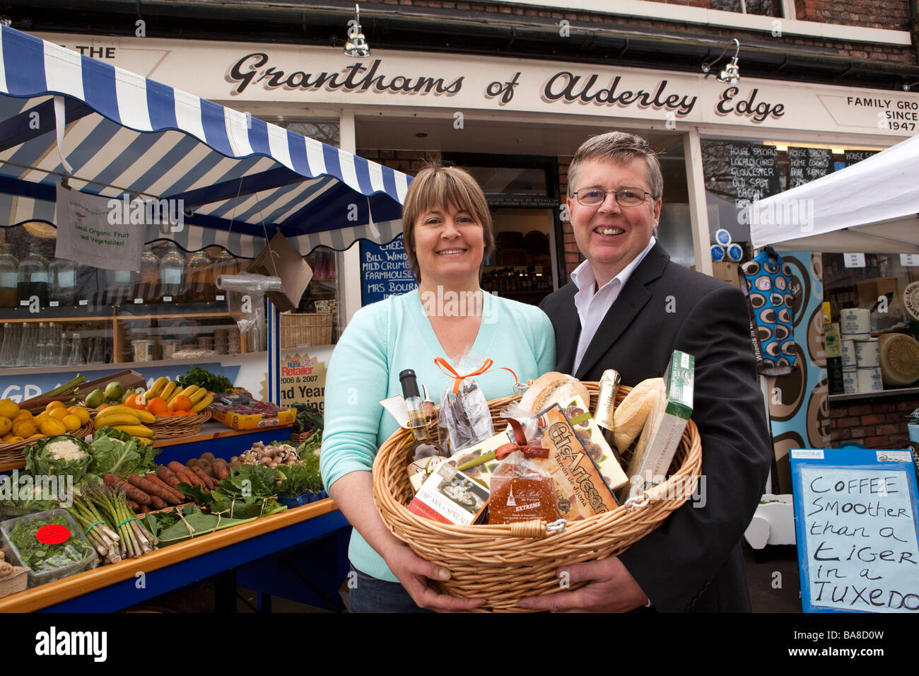UK England Cheshire Alderley Edge Mike and Gill Grantham outside their traditional village grocers shop - Stock Image