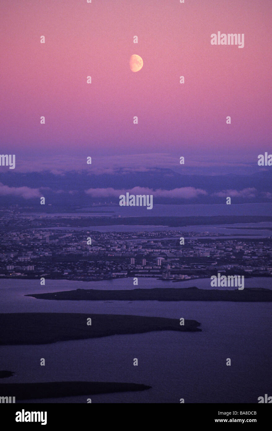 Moon in sky above Reykjavik on night of summer equinox Iceland - Stock Image