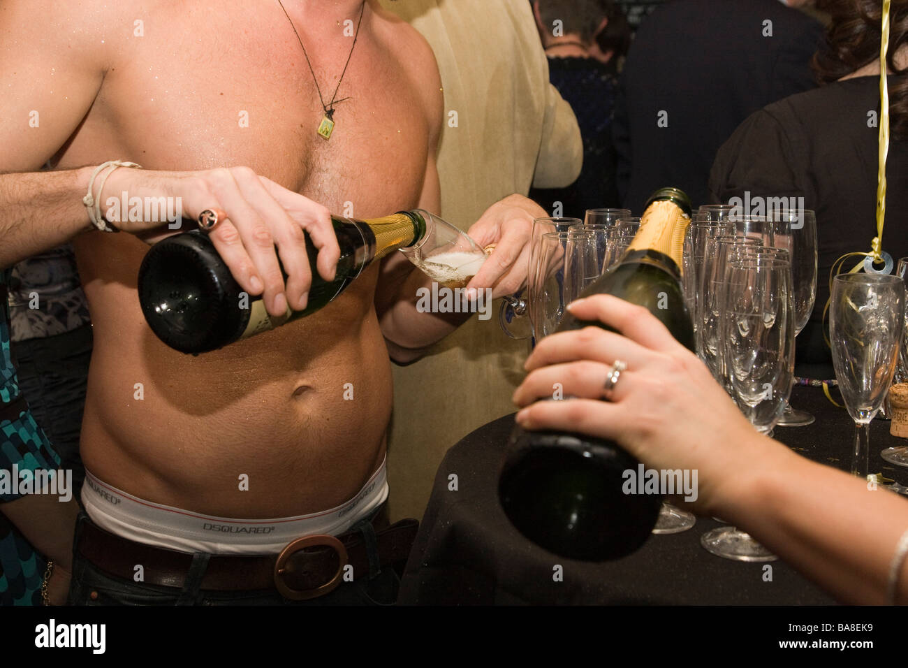 christmas party drinking bubbly champaign - Stock Image