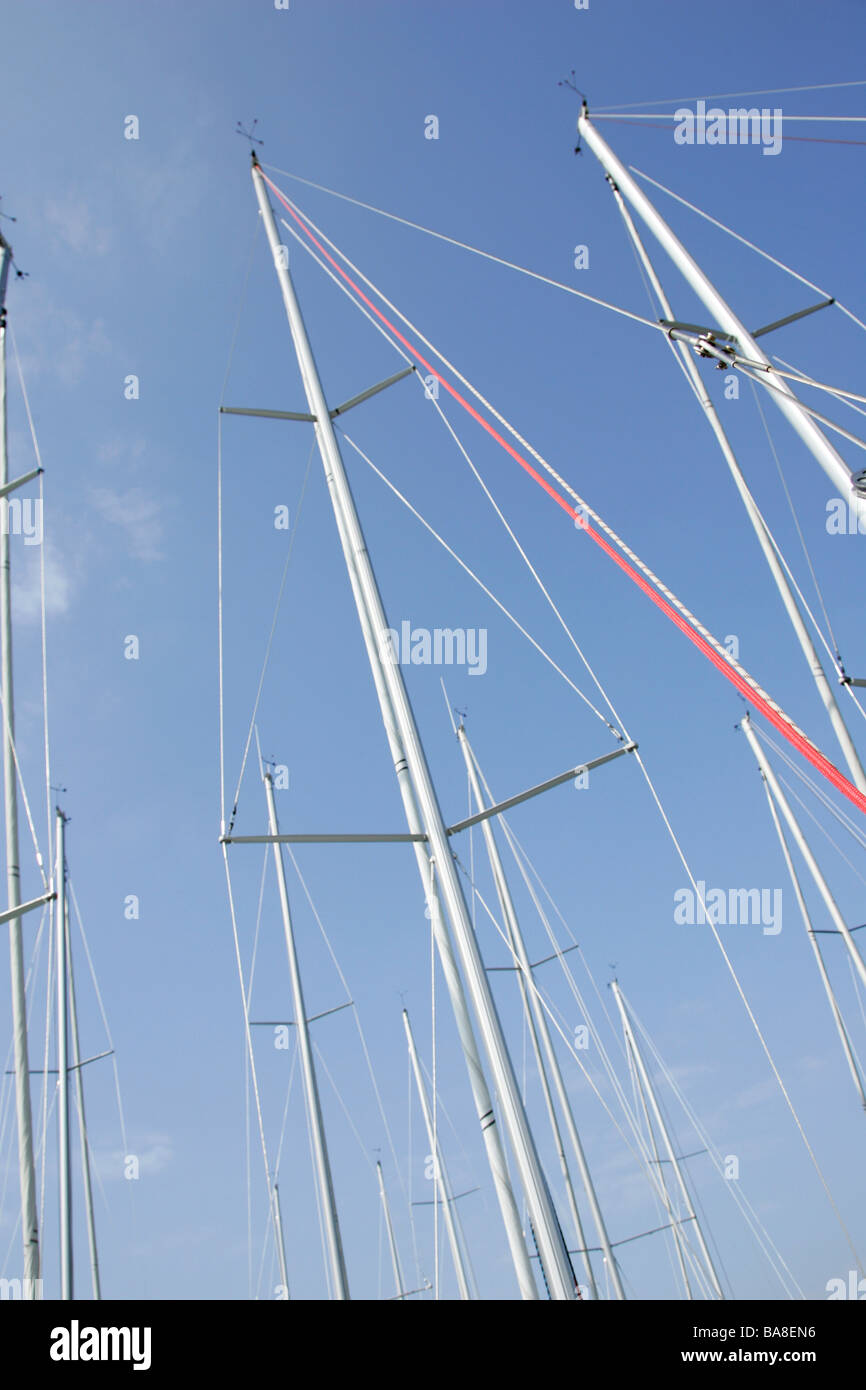 Sailboat Masts with Blue sky - Stock Image