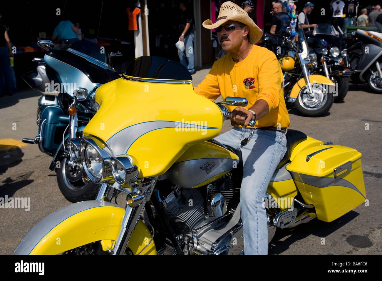 Cowboy hat rider on canary yellow motorcycle annual Sturgis Rally South  Dakota USA db35fba962c