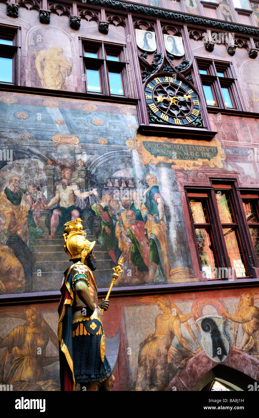 Front arcadehe of the Basel town hall (rathaus) showing a clock,  suit of armor and murals - Stock Image