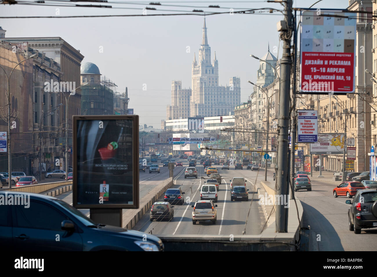 Moscow traffic with one of the seven sisters Stalin era Kurdinskaya square buildings in the background, Moscow, Russia. Stock Photo