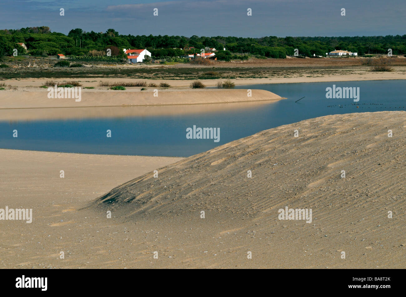 Dunes and lagoon at beach Praia de Melides - Stock Image