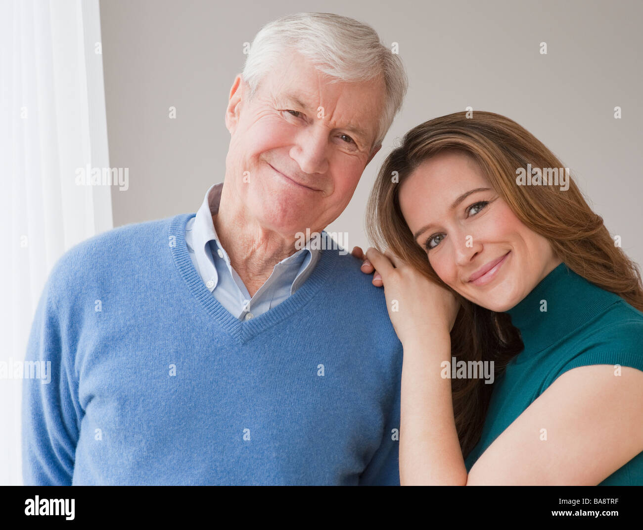 Portrait of senior man and daughter - Stock Image