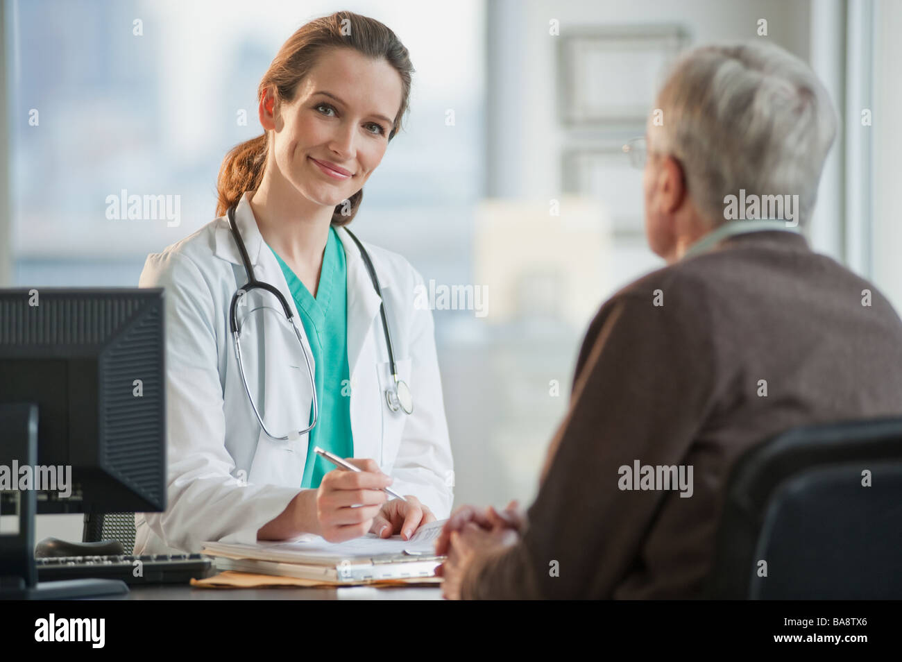 Doctor consulting with senior man - Stock Image