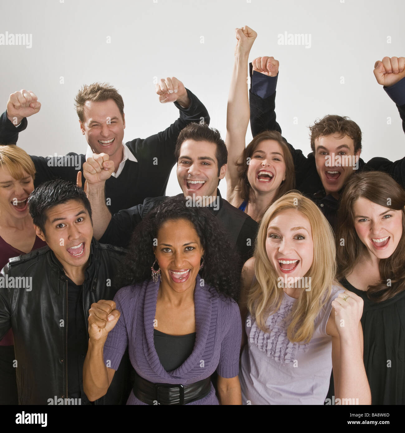 Group of friends cheering - Stock Image