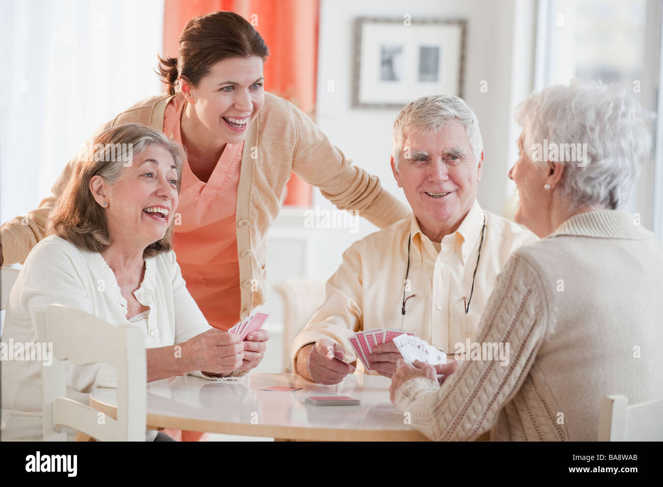 Senior adults playing cards - Stock Image