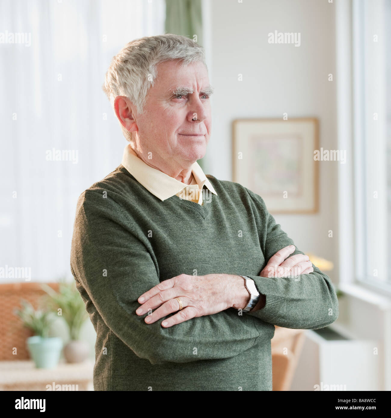 Senior man with arms crossed - Stock Image