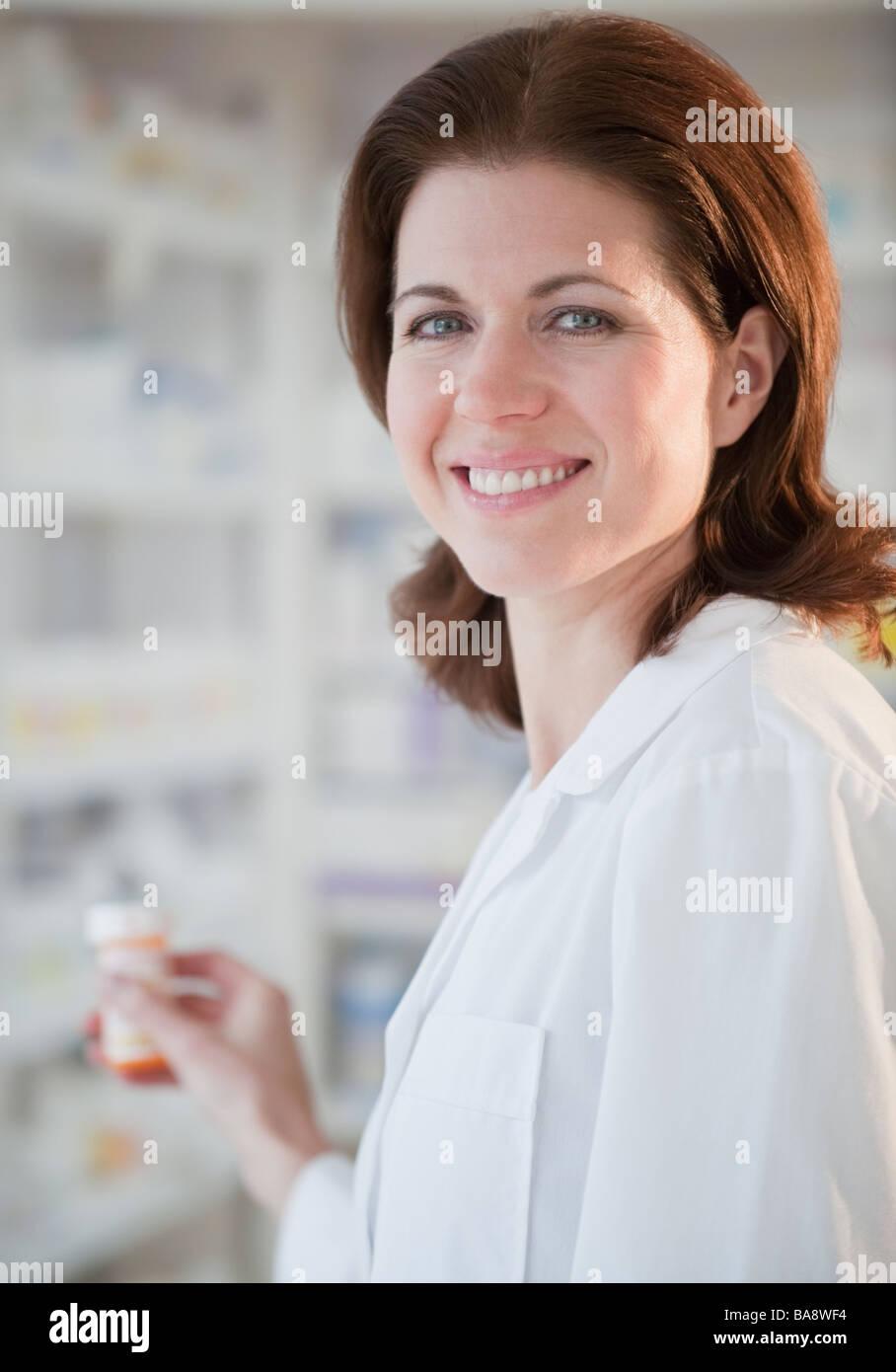Pharmacist filling prescription - Stock Image