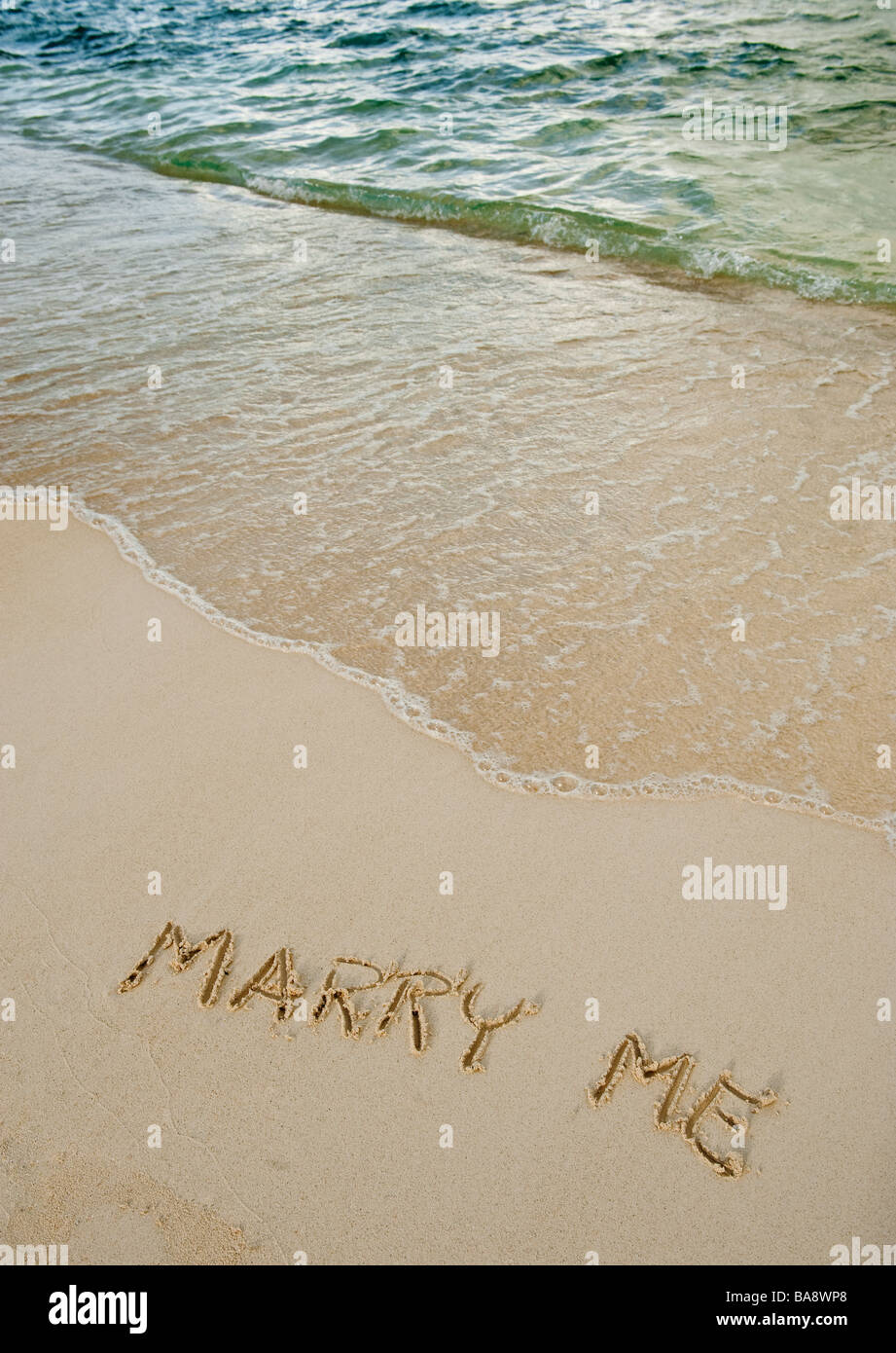 Marry me message written in sand - Stock Image
