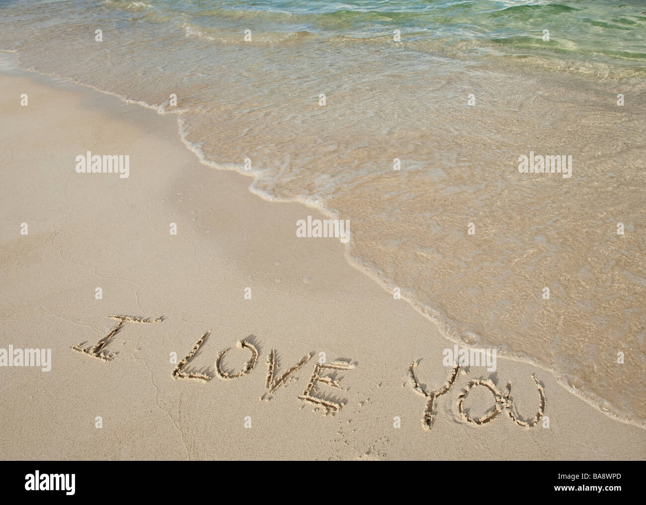 I love you message written in sand - Stock Image