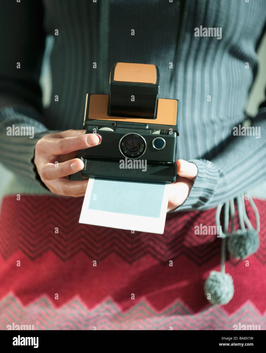 Woman holding vintage camera - Stock Image