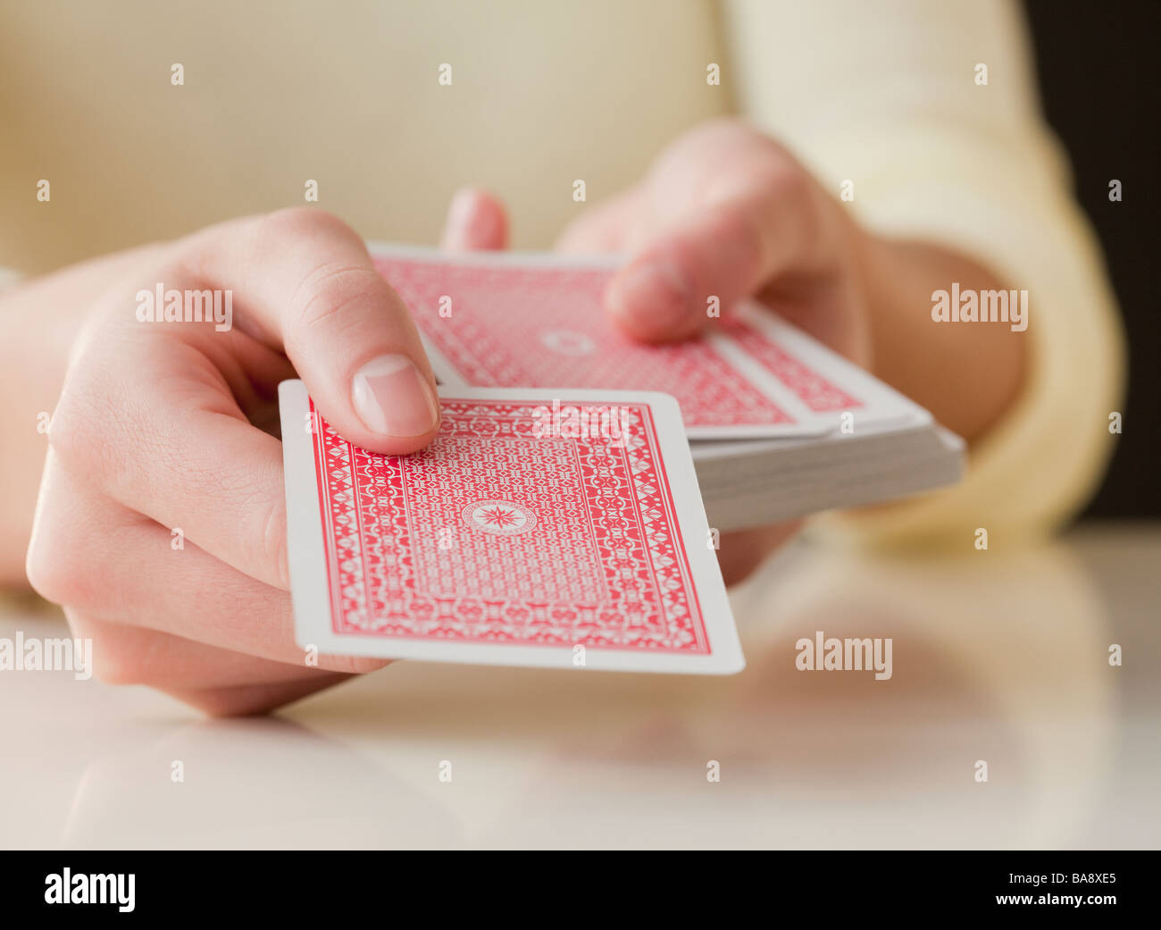 Woman dealing cards - Stock Image