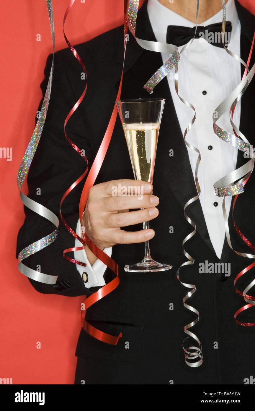 Man celebrating New Years - Stock Image