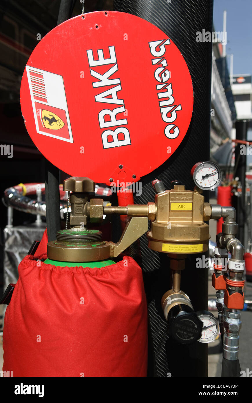 pressured gas bottle and lollypop in Ferrari Box at racetrack at Formula One testing sessions Stock Photo