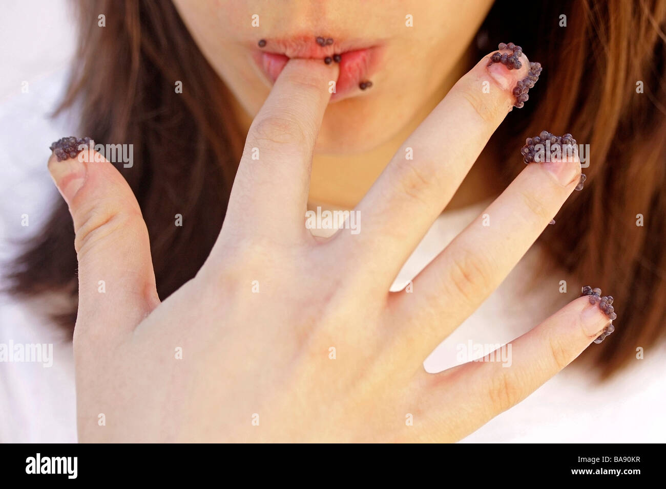 Eating caviar with fingers - Stock Image