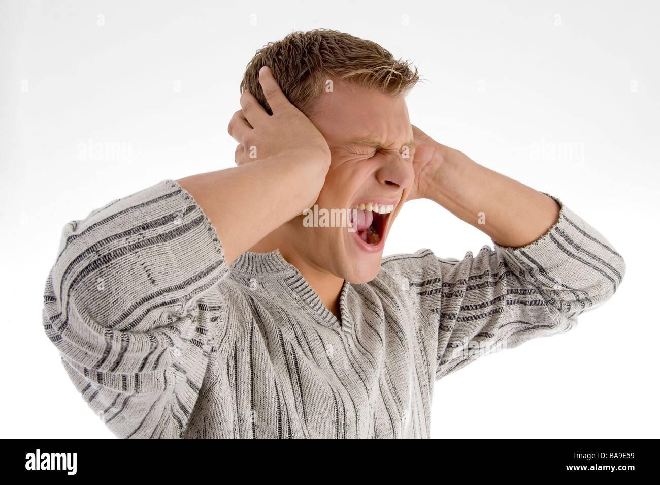 man shouting loudly - Stock Image