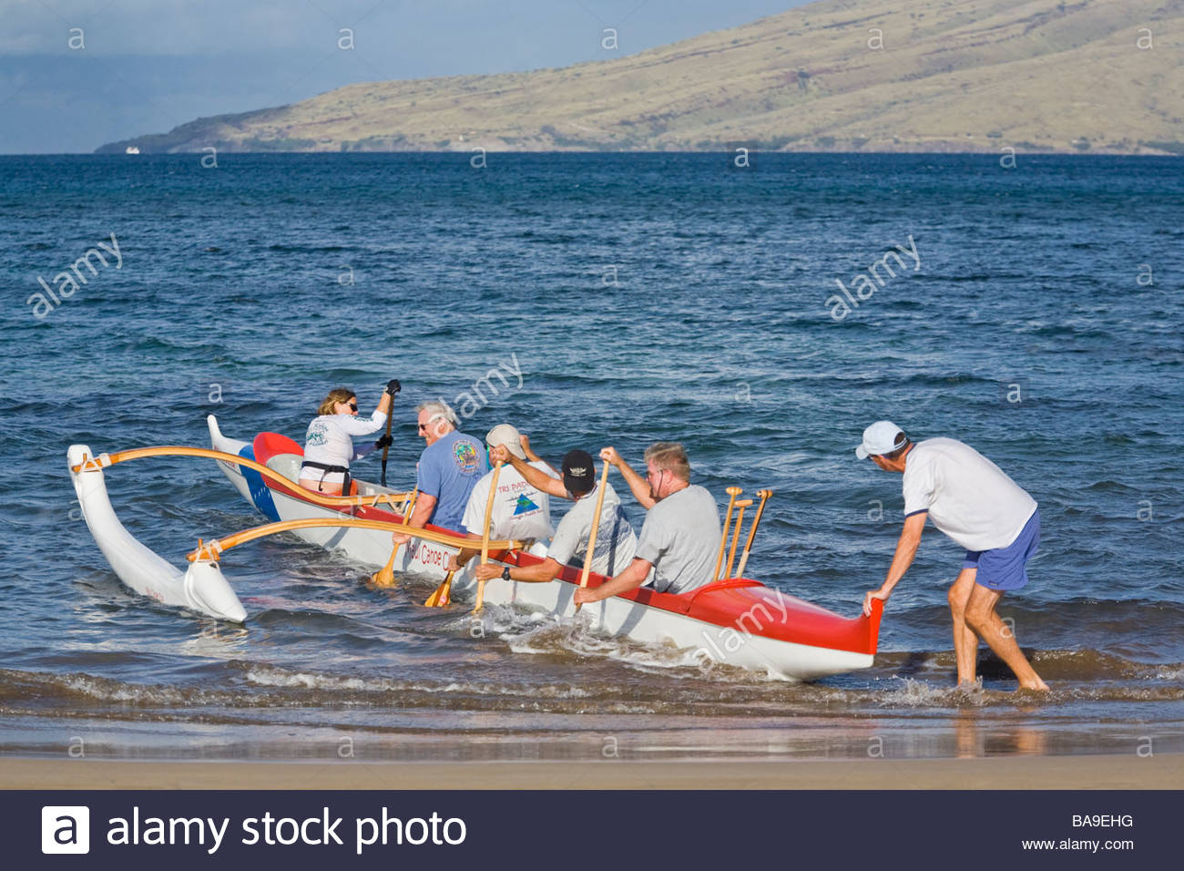 Outrigger canoe paddled by seniors tour group at Kihei on the island of Maui in the state of Hawaii USA - Stock Image