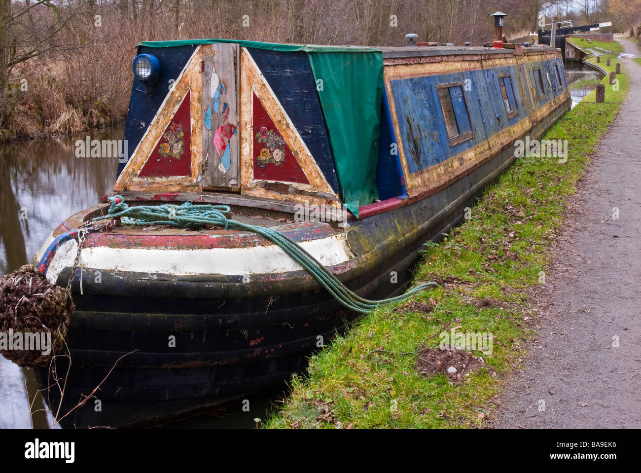 neglected 'narrow boat' in need of some TLC - Stock Image