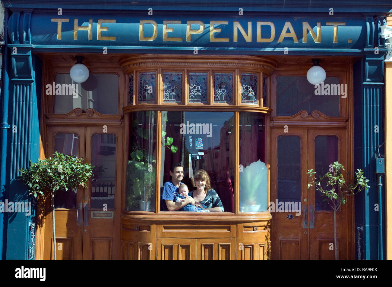 Young family in their home, a converted pub in Brighton England UK - Stock Image