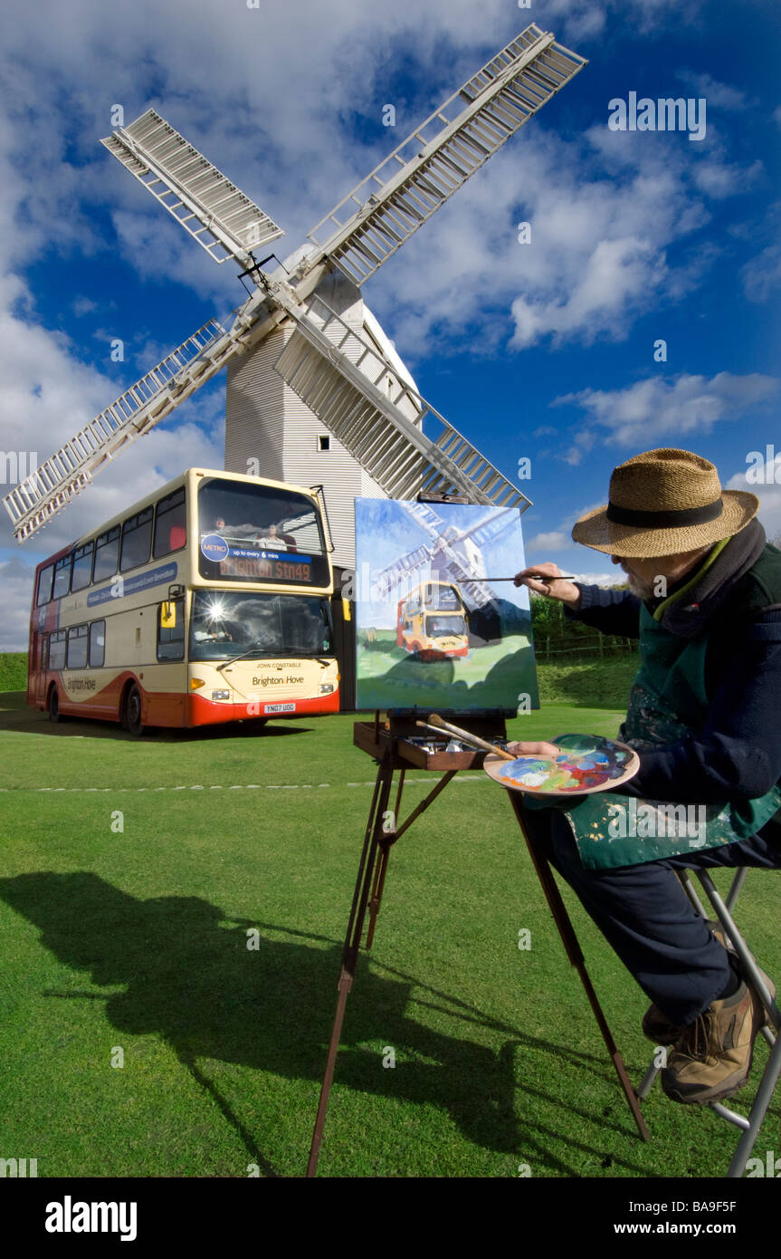 Jill Mill at  Clayton Sussex being painted by Colin Ruffell with a double decker bus called John Constable. Stock Photo