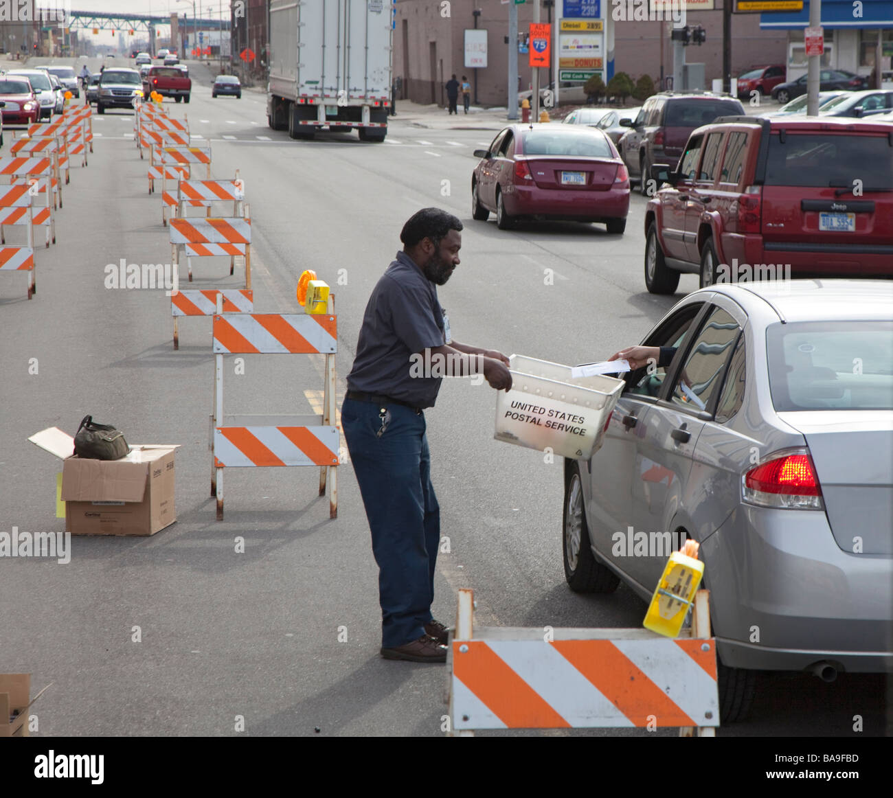 Postal Workers Collect Income Tax Returns Just Before Filing Deadline - Stock Image