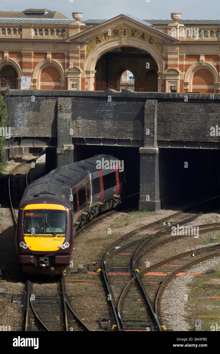 An East Midland Trains surburban DMU train arrives at Leicester Railway station. - Stock Image
