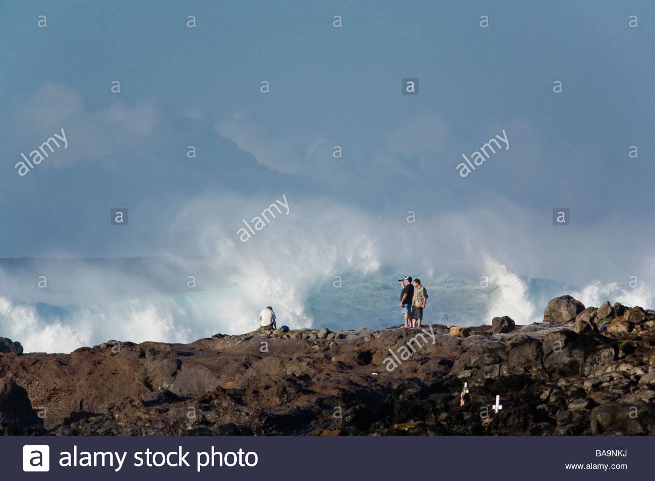 Tourists too close to dangerous surf at Hookipa Bay on the island of Maui in the State of Hawaii USA - Stock Image