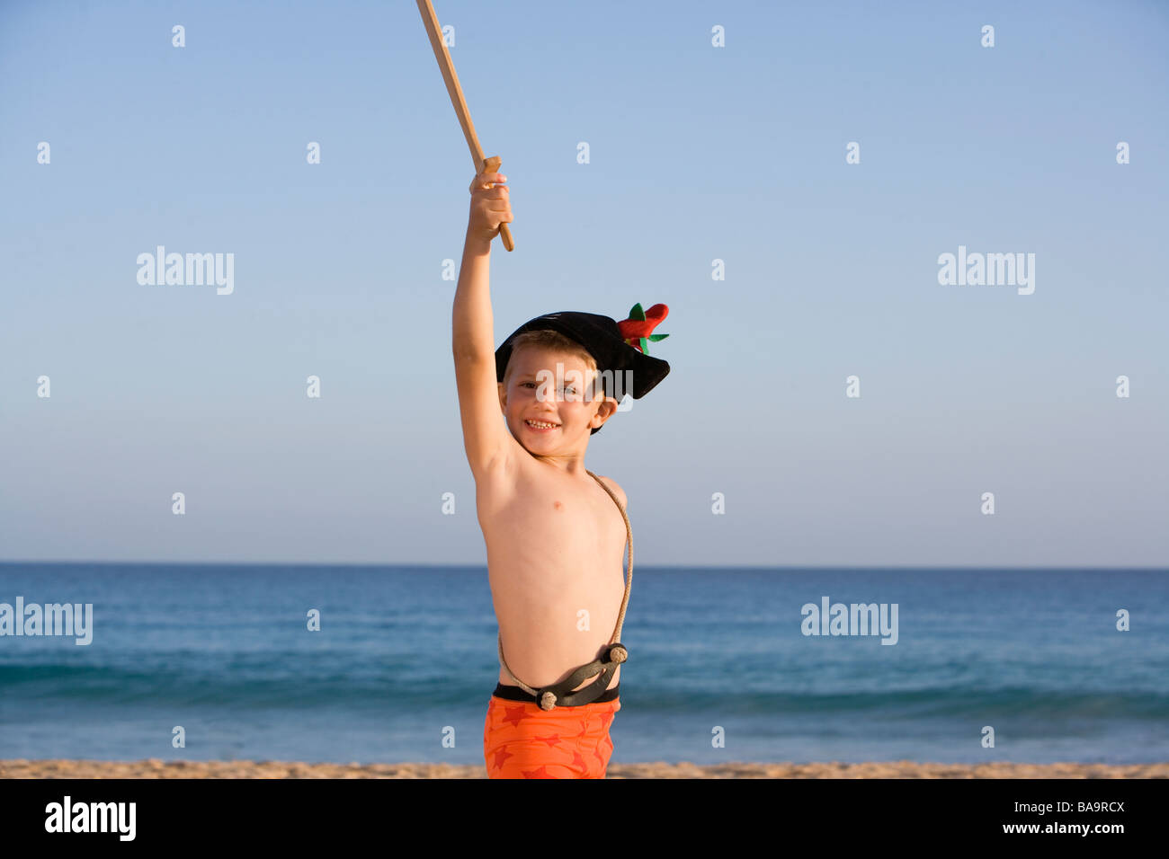 A playing child on the beach. Stock Photo