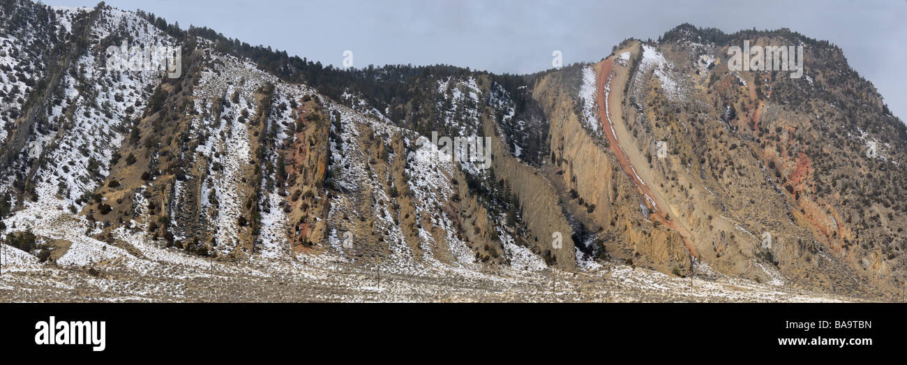 Panorama of vertical rock slabs of sedimentary rock at Devils Slide on Cinnabar Mountain from Old Yellowstone Trail - Stock Image