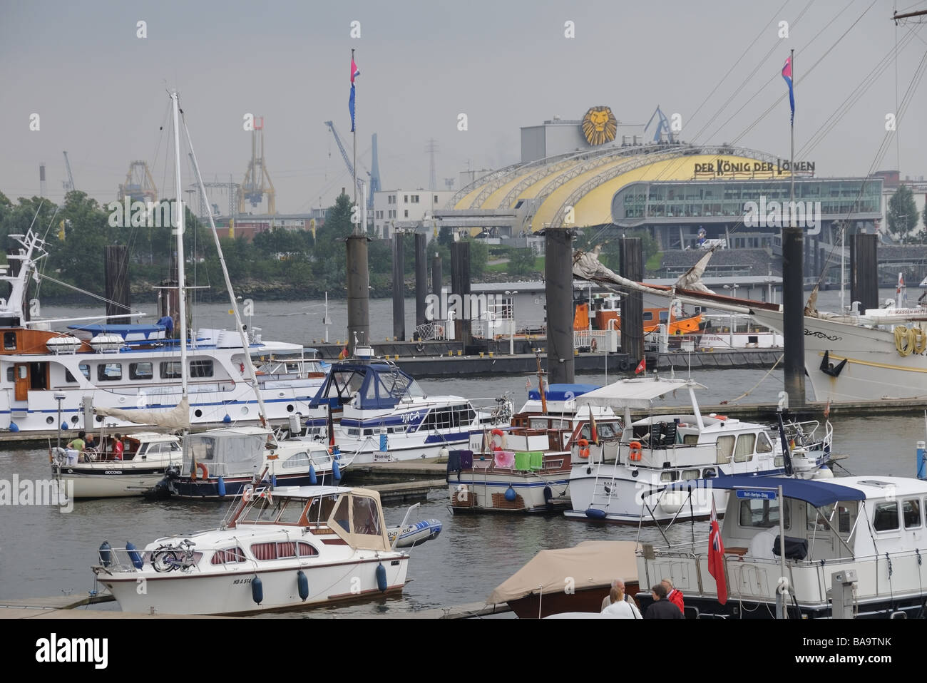 Hamburg's harbour, Germany.Europe,  barges, launches in  foreground and the performance tente for 'Lion - Stock Image