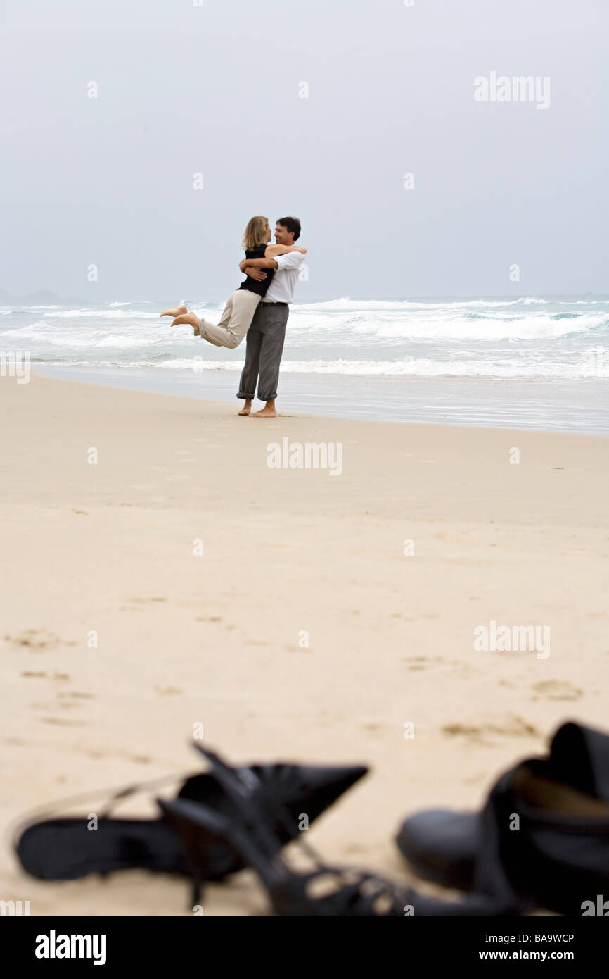 A middle-aged couple embracing on the beach, Brazil. Stock Photo