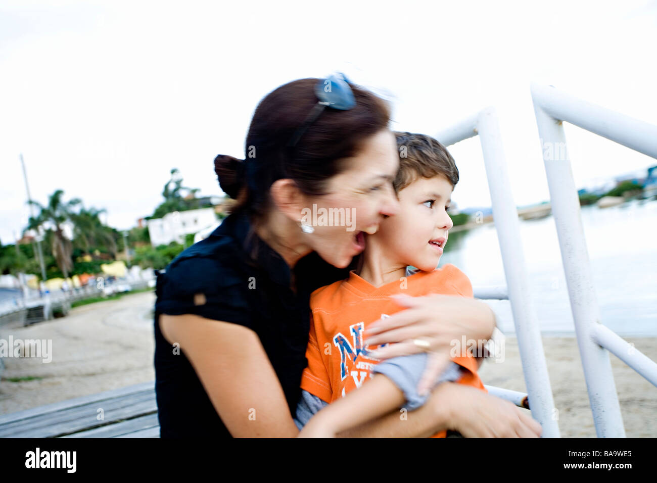 A happy mother huging her son, Brazil. - Stock Image